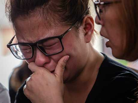 Ningsi Ayorbaba weeps as she await news of her husband Paul Ferdinan Ayorbaba, a victim of the crashed flight. Picture: Getty