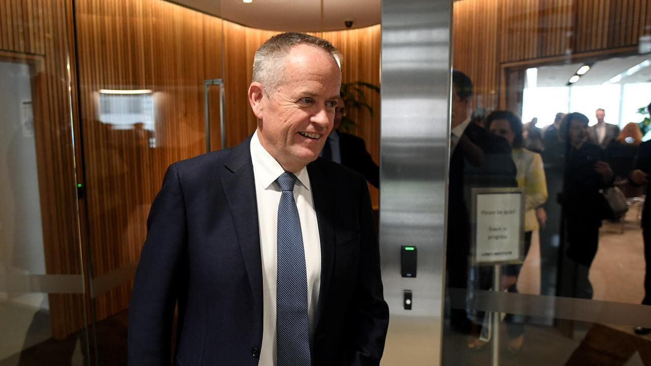 Federal Leader of the Opposition Bill Shorten even has to keep the smiles plastered on when he's in a lift. Picture: Joel Carrett/AAP