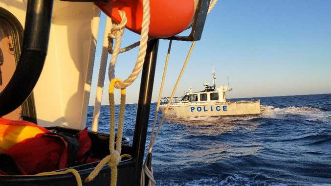 Emergency services were called to rescue a man whose tinny had capsized off Brunswick Heads.