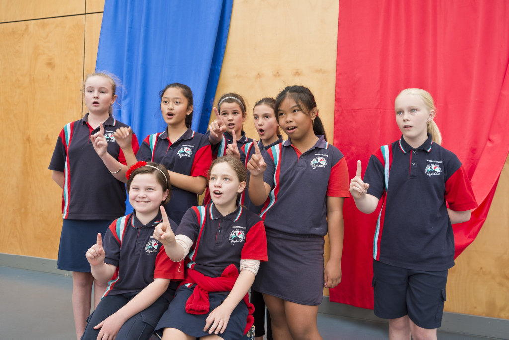 Harristown State School choir members (back row, from left) Indi Richards, Andrea Martinito, Tahlia Wyatt, Shayla Niez, Maddison Coleman and (front row) Bella Lampey (left) and Allahna Clarke get ready for Music: Count Us In, the national synchronised singing of One Song, Thursday, November 1, 2018.