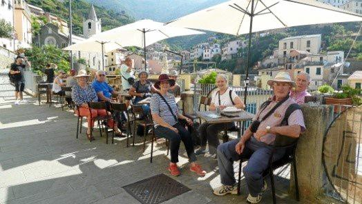 Some of the Redcliffe City Mixed Probus club members enjoy coffee time in Cinque Terre on their recent tour of Italy.
