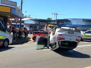 Car flips in crash on busy intersection