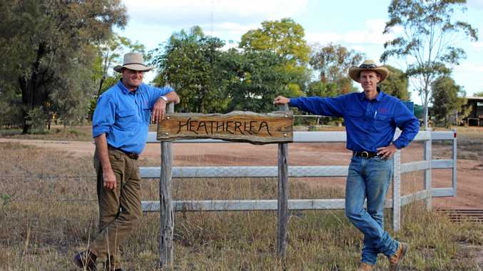CELEBRATION OF LIFE: Lachlan Hughes (pictured right) and his father Philip out the front of their property Heatherlea.