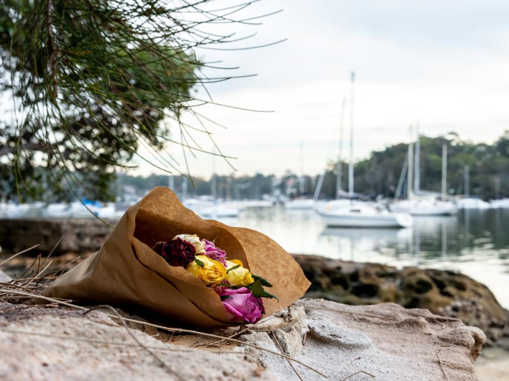 Flowers laid in honour Haddad at the Lane Cove River shoreline.