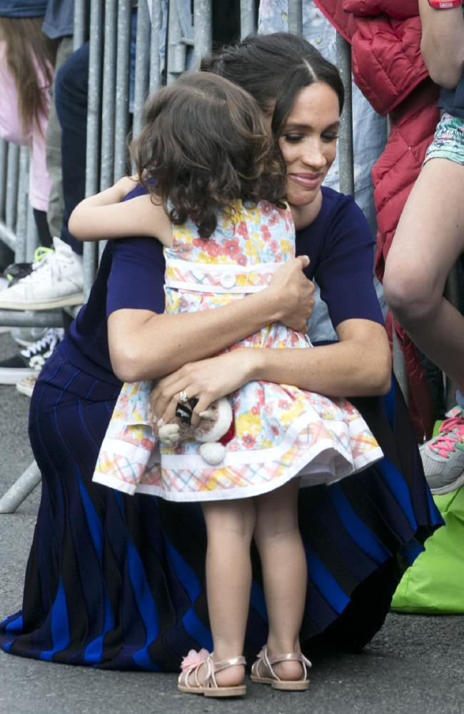 The lucky little girl got a hug from Meghan. Picture: Alan Gibson-Pool/Getty Images