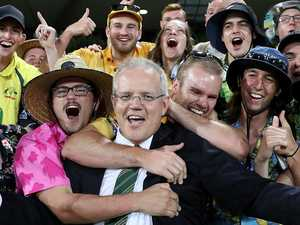 ScoMo wins over cricket fans with beer scull