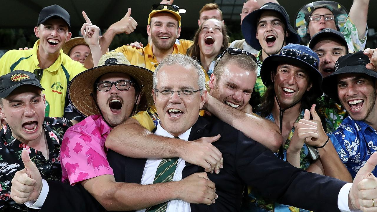 PM Scott Morrison is mobbed by the crowd after the end of the Prime Minister's XI vs South Africa match, a day-night one-day at Manuka Oval in Canberra. Picture Kym Smith