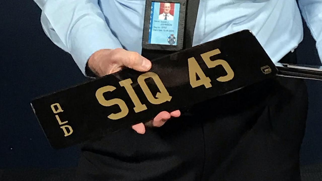 Superintendent David Johnson with some of the false plates that have been confiscated by police.