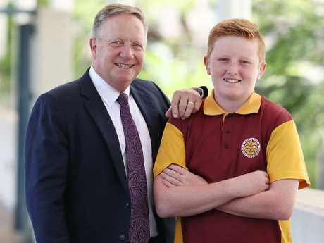 Cricket legend Ian Healy with Byron Wallace, 11, at the Gabba yesterday. Picture: Peter Wallis