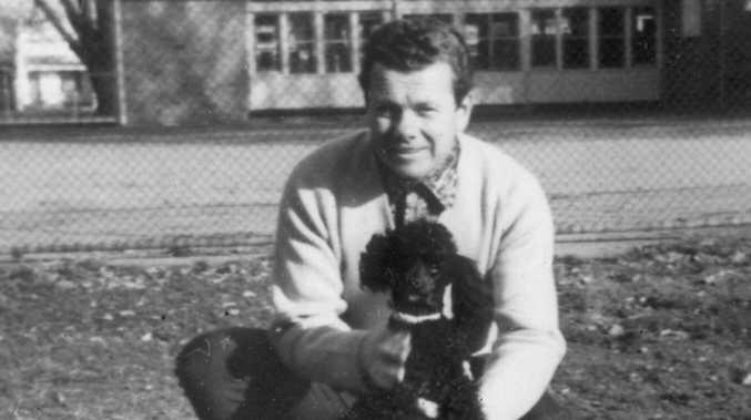 Hitman James Bazley with his pet poodle.