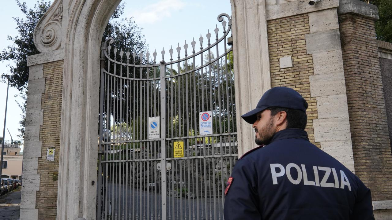 A police officer guards the entrance of the Apostolic Nunciature, the Vatican's embassy to Italy, in Rome.  Picture:  AP