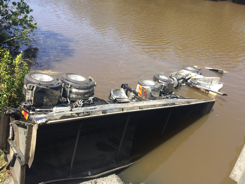 A truck has crashed over a bridge on Teven Road, Teven, becoming submerged in Emigrant Creek.