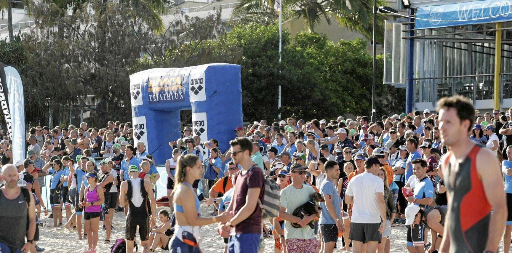 Spectators and athletes enjoy the 2016 Noosa Triathlon.Overview of start of swim leg at Main Beach Noosa.