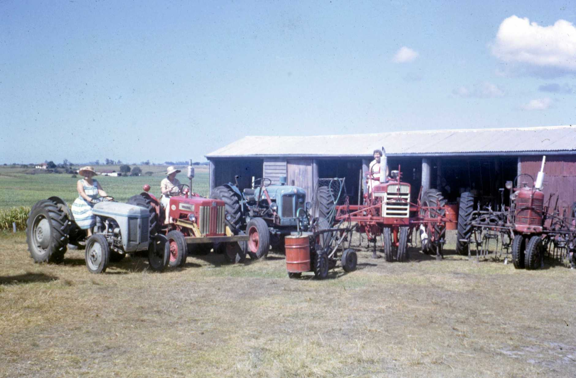 Tractors, machinery and shed on the Garrett family cane farm, Bli Bli, June 1965.