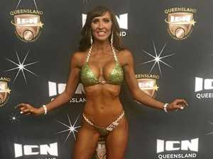 Mum of two, 40, wins world body building championship title