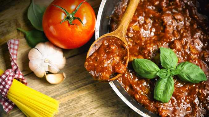 A vegan woman has been taken to court after threatening her with a knife for making traditional Italian meat sauce.