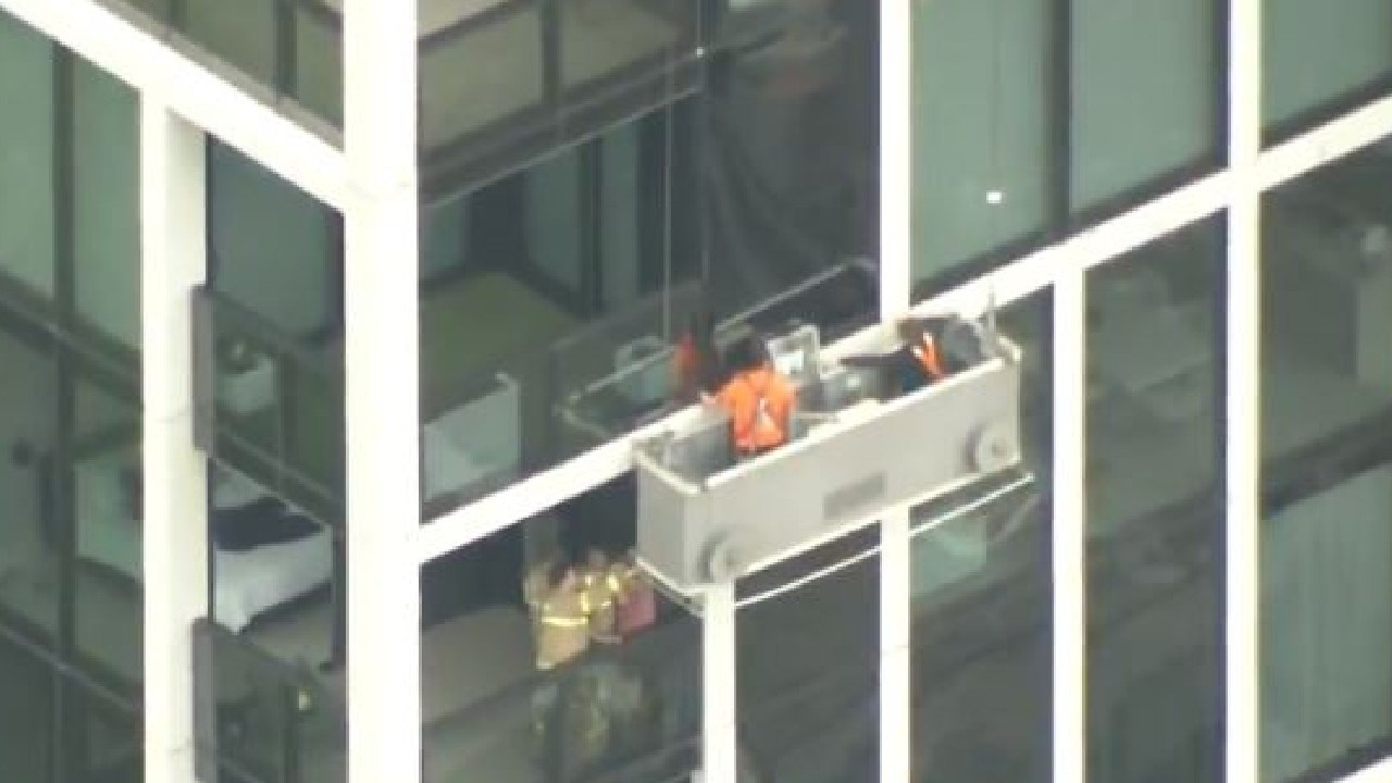 Two window cleaners are trapped on Spring Street tower.