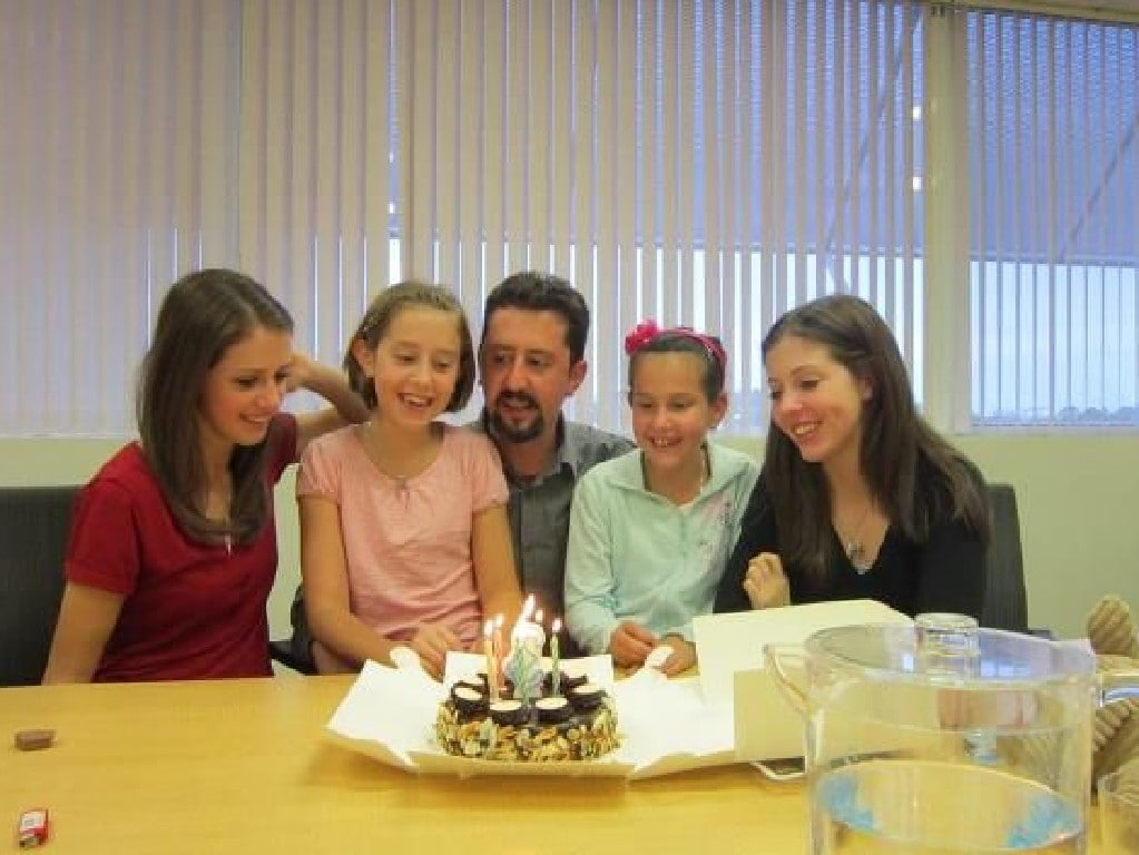Tommaso Vincenti on his second custody visit with his four daughters. He took a cake to celebrate the birthdays he had missed over two years during the custody battle. Picture: Facebook