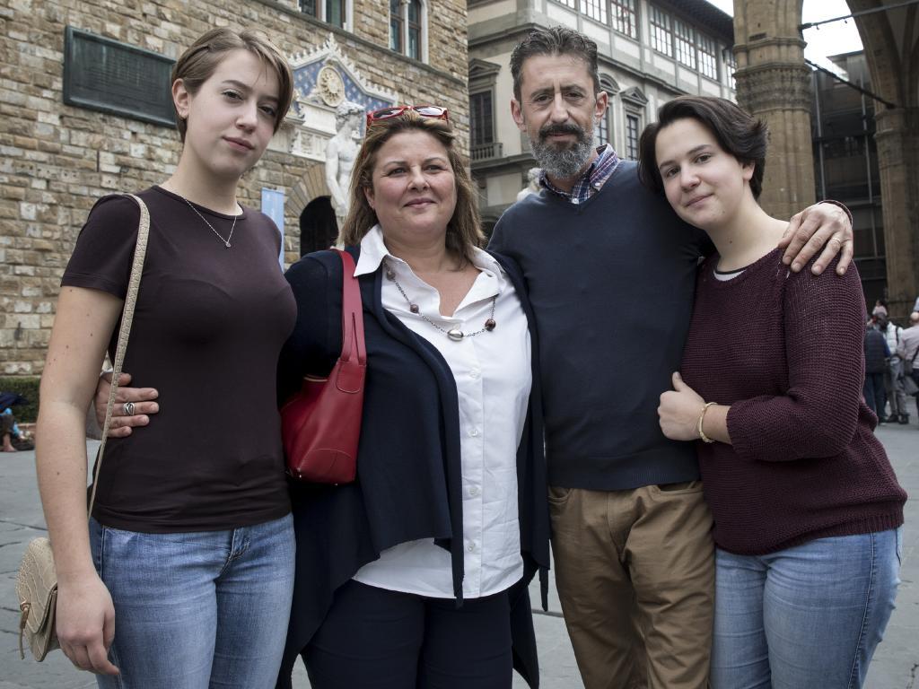 Christine and Lily with their father Tommaso Vincenti and his partner Georgia Pettinicchio. Picture: Ella Pellegrini