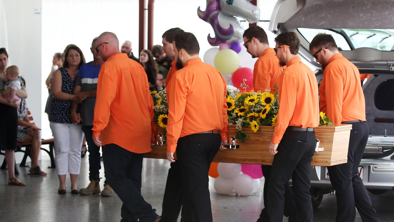 Friends and family of Toyah Cordingley attend the 24-year-old's celebration of life service at the Cairns Funeral Directors Chapel, Manunda. Pallbearers dressed in orange carry Toyah's casket into the chapel to start the service. PICTURE: BRENDAN RADKE