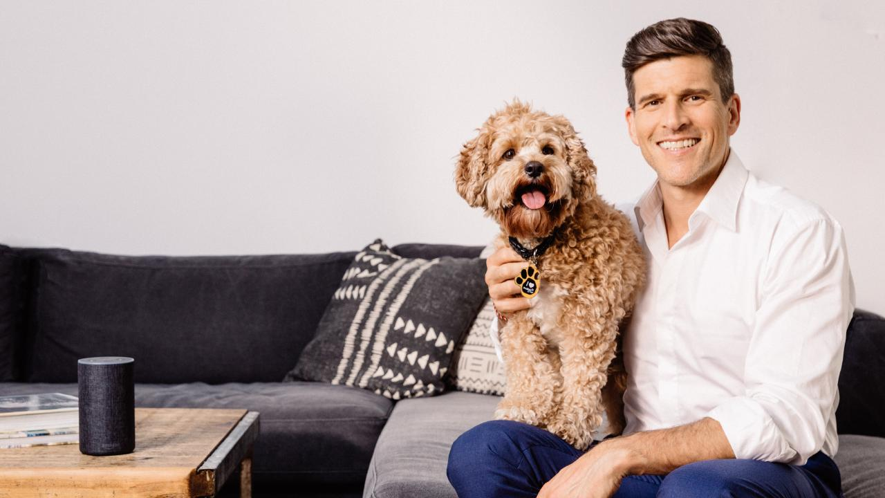 'From chasing tails to soothing tales.' TV presenter Osher Gunsberg, pictured with his pet pooch Frankie, helped to create the collection.  Source: Audible
