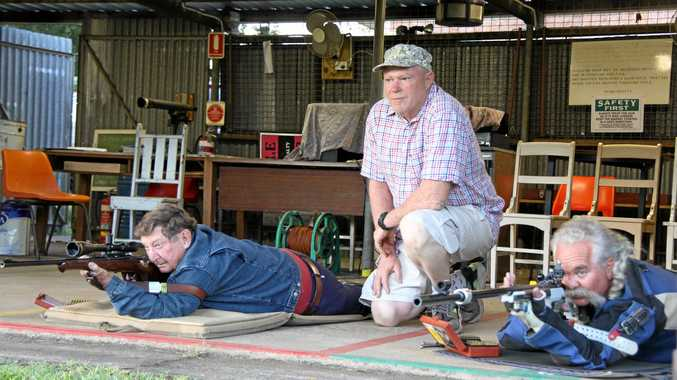 ON TARGET: The Lismore Target Rifle Club is hosting a two-day event on November 10 and 11 at its Tuncester range.  A-grade shooters Ross Barnes and Derek Cassar lie on their mats and get ready to fire as Stephen Jones (kneeling) watches the targets.