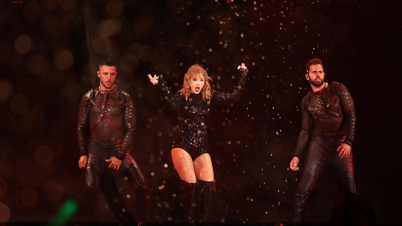 Taylor Swift arrived late on stage after fans were lashed with rain from an electric storm. Photo Mark Metcalfe.