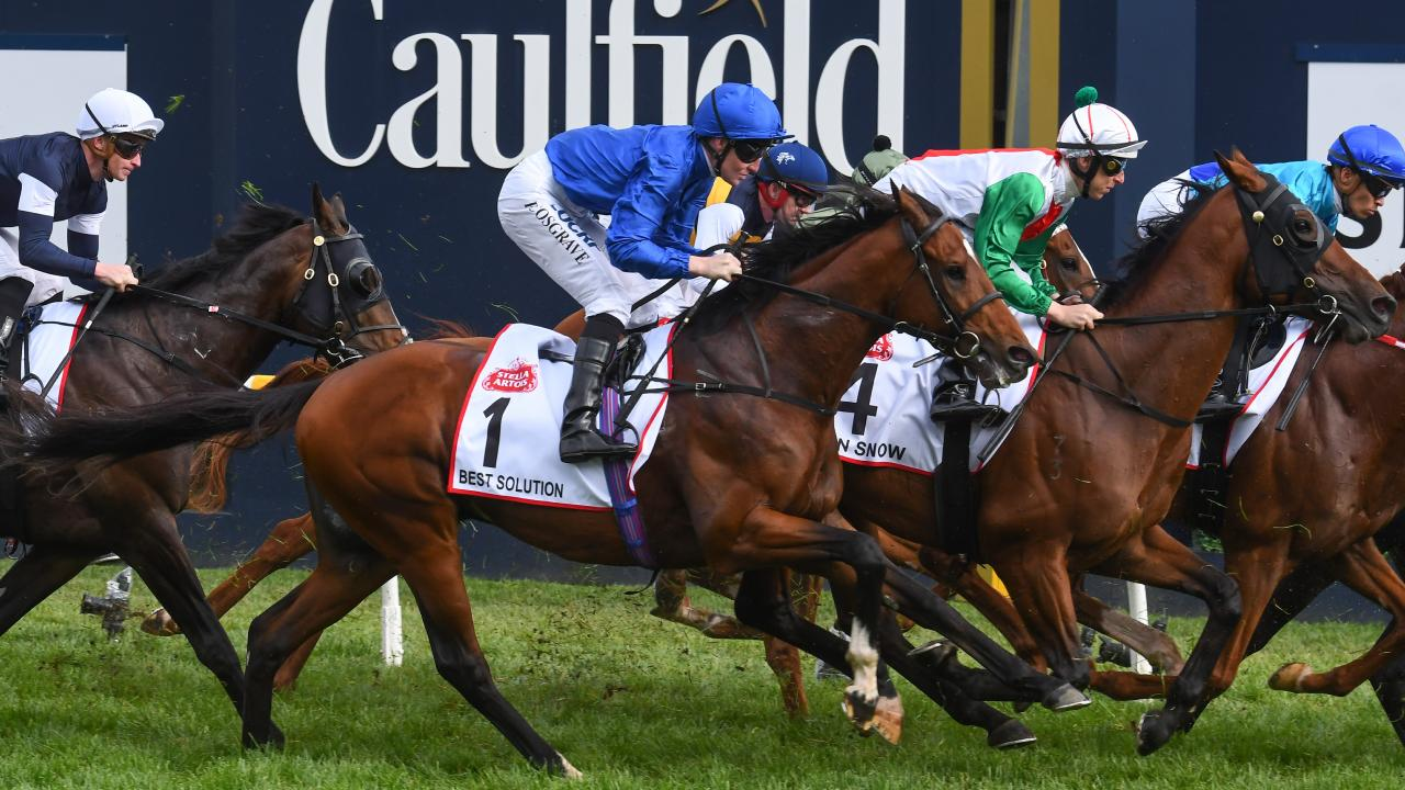 Pat Cosgrave and Best Solution approach the first turn before going on to win the Caulfield Cup. Picture: Getty Images