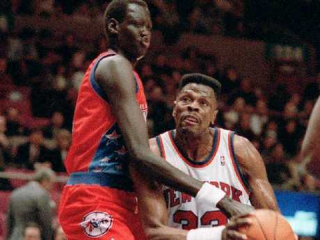 Patrick Ewing, right, is blocked by Philadelphia 76ers' Manute Bol in a 1993 NBA game.