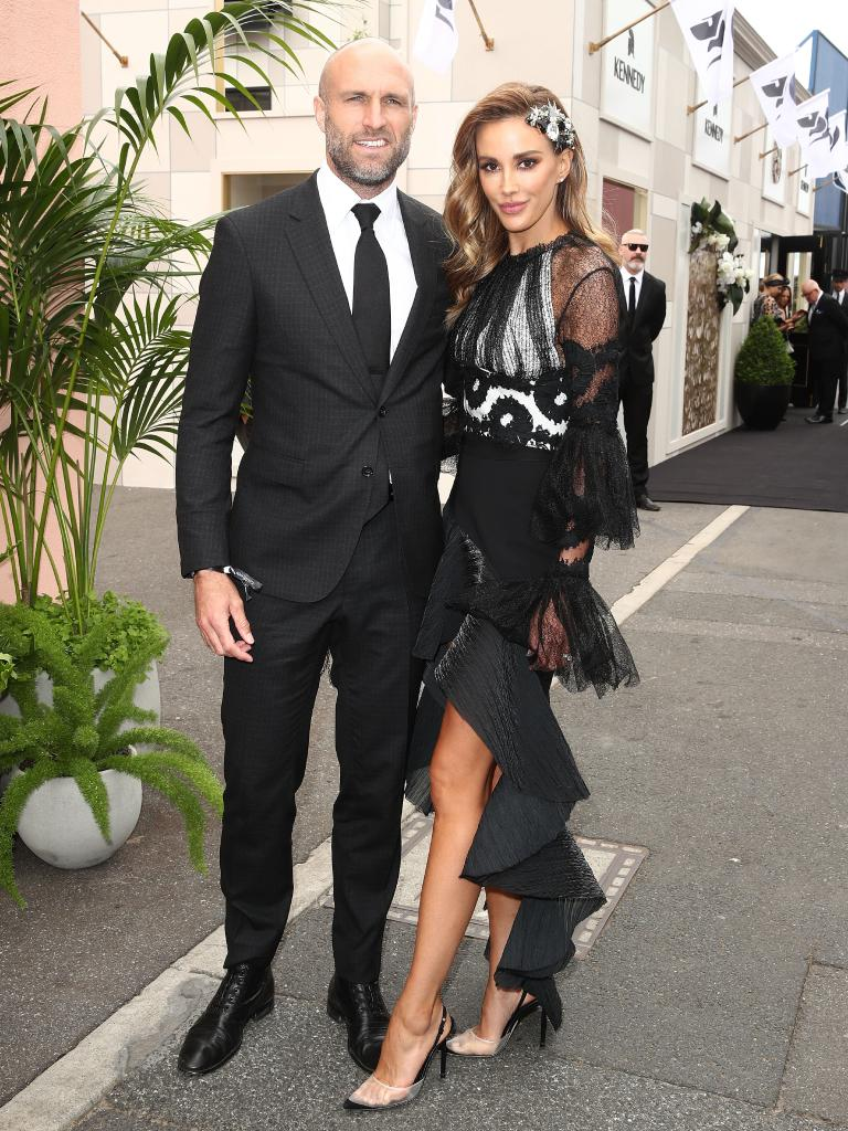 Chris and Rebecca Judd arrive at Derby Day at Flemington Racecourse. Picture: Getty Images