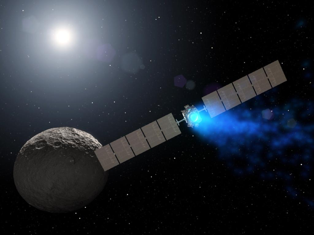 This illustration made available by NASA depicts the Dawn spacecraft orbiting the dwarf planet Ceres. If it was able to suck fuel from the void of space, it would not have been forced to shut down as it did this month. Picture: NASA