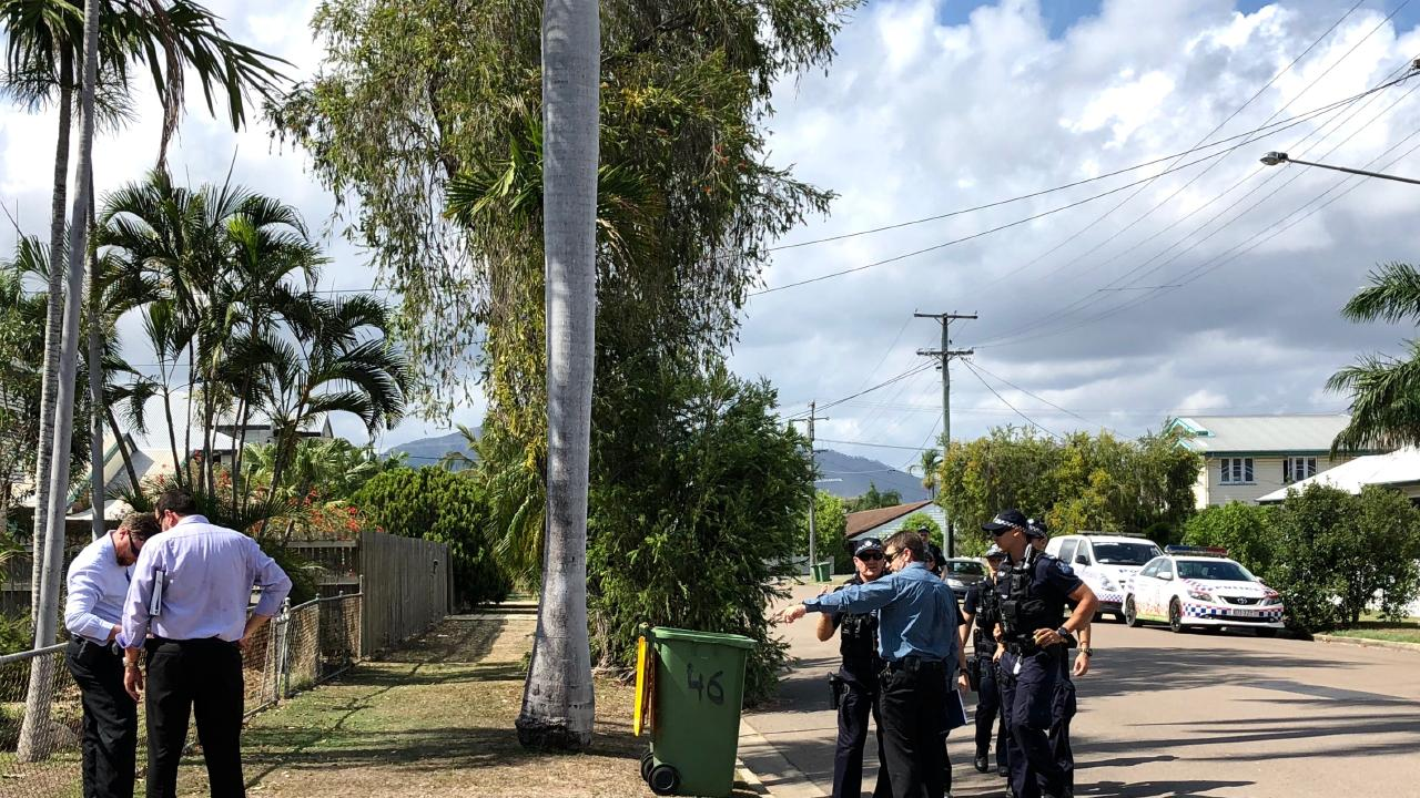 Detectives on the scene at Latchford St, where a woman was allegedly stabbed repeatedly by a man unknown to her. Detectives find the knife blade next to the mailbox.