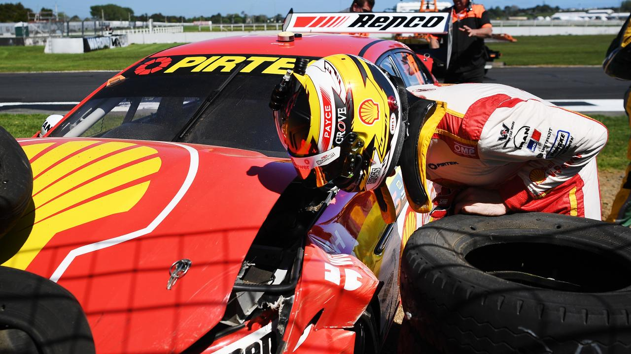 Scott McLaughlin inspects the damage to his car after crashing. Picture: Getty