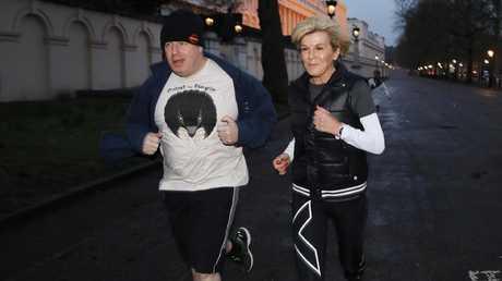 Julie Bishop and Boris Johnson go for a pre-sunrise run in St James Park in London. Picture: Ella Pellegrini