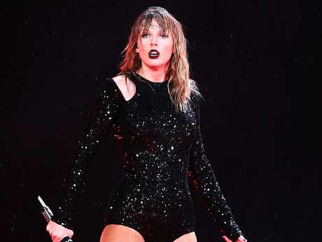 Swift arrived on stage late after an electrical storm lashed concert goers. Picture: Mark Metcalfe.