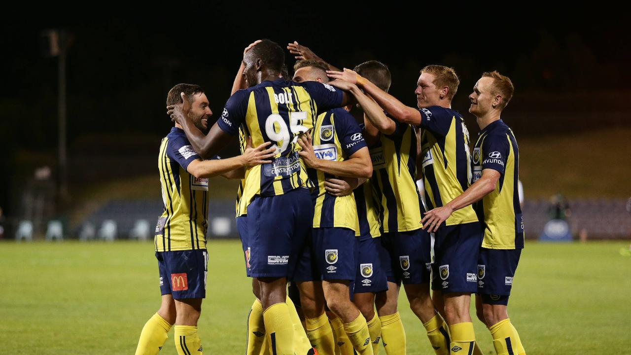 Usain Bolt celebrates with Mariners teammates after scoring his first goal during Central Coast's pre-season clash with Macarthur South West United. Picture: Brett Costello