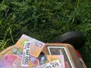 Residents find thousands in $5 notes in backyards