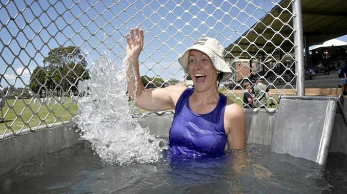 STAYING COOL: Centenary Heights State High School teacher Jodie Coprum stayed cool as she got dunked at a school event yesterday.