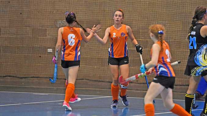 GOAL: Maryborough Orange's Emma Bellingham high fives her team mate after scoring a goal to level the score.