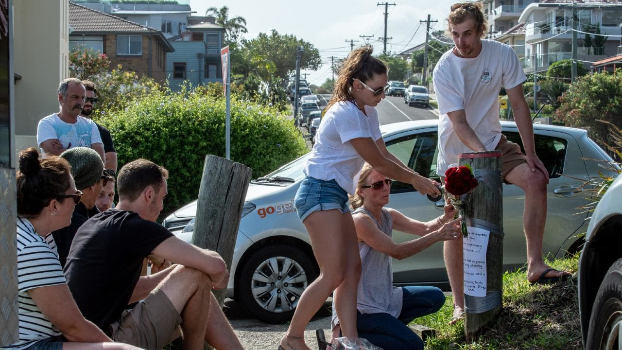 Friends of 26-year-old Liam Anderson, son of Angry Anderson, are pictured assembled at the site of Liam's murder. Liam was murdered in Queenscliff on Sunday morning, November 4, 2018. Picture: Monique Harmer