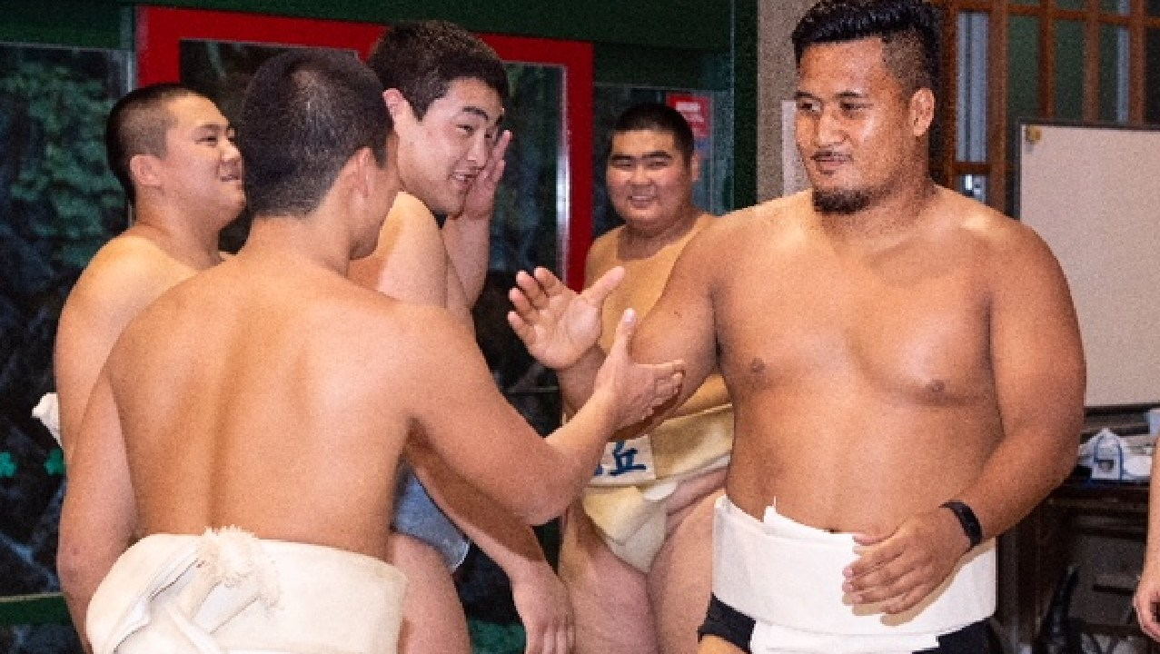 Wallabies hooker Brandon Paenga-Amosa tries his hand at sumo wrestling in Japan.
