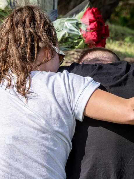 Devastated friends support one another in Freshwater. Picture: Monique Harmer