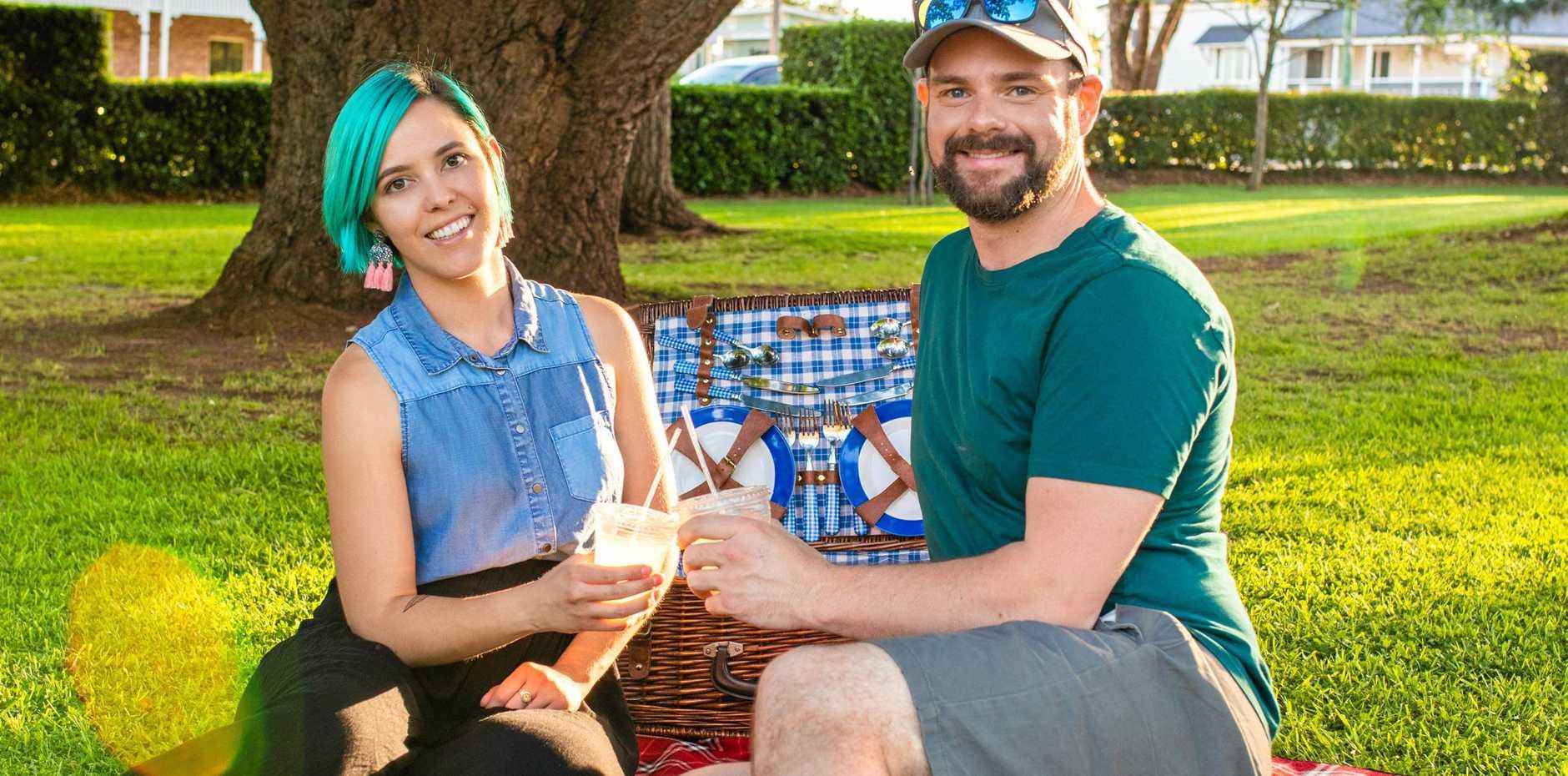 Tim Swinson and Aleisha Cowan enjoy a picnic in Laurel Bank Park.