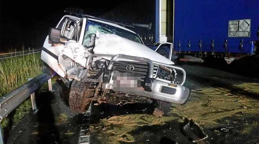Two men were hospitalised on Wednesday night following a crash on the highway near Caloundra where a Toyota Landcruiser and B-double truck collided head on.
