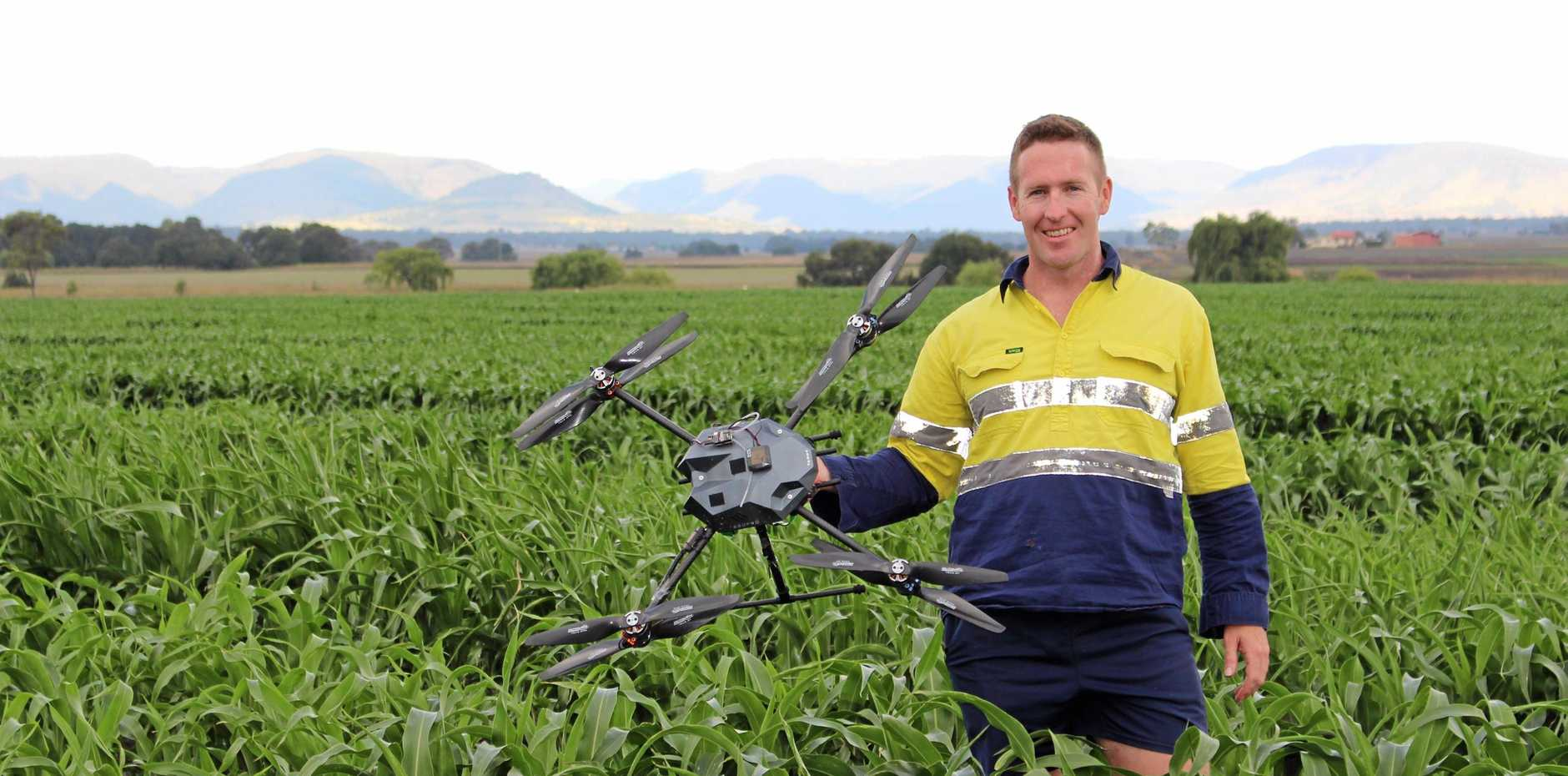 FUTURE OF FARMING: Department of Agriculture technical officer Ken Laws uses drones and computer technology to create complex three-dimensional maps of sorghum crops to use in plant analysis.