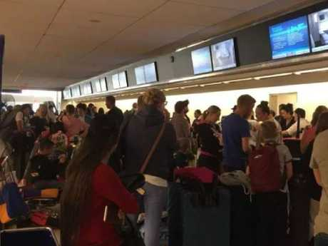 Chaos at the check-in desk. Picture: Lee Sullivan