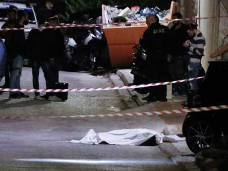 Macris was reportedly shot with four bullets as he was getting out of his Smart car in Voula near where he lived in Athens. Picture: Proto Thema