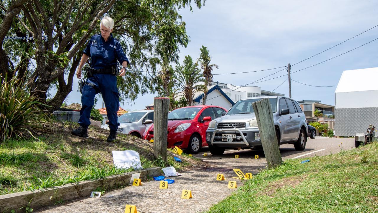Police comb the crime scene.