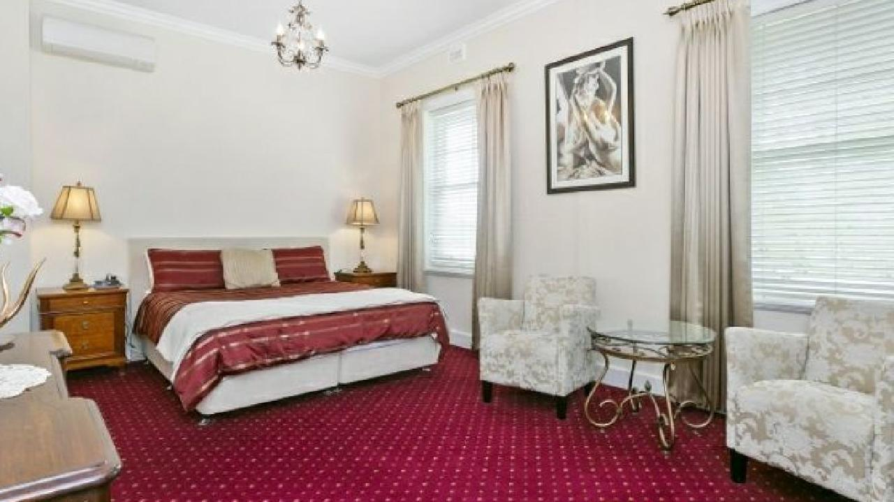 Plenty of old world charm on show in one of the five bedrooms.