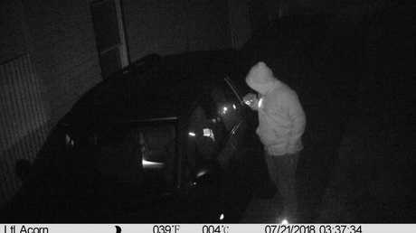 A would-be burglar who was caught on a home security camera moved on because the man's home and car were locked with no valuables in sight.